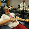 Ninth Triennial Gathering |  Denise Bakkum, Moorhead, MN, takes time to give blood in the exhibit hall