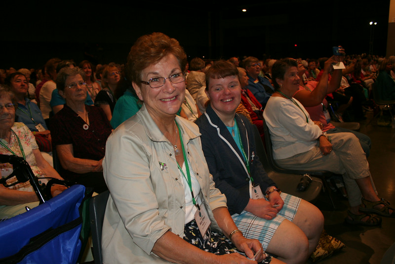 Ninth Triennial Gathering | Mary Ellen Kiesner (left), former churchwide executive board president, sits with her daughter Amy, during closing worship