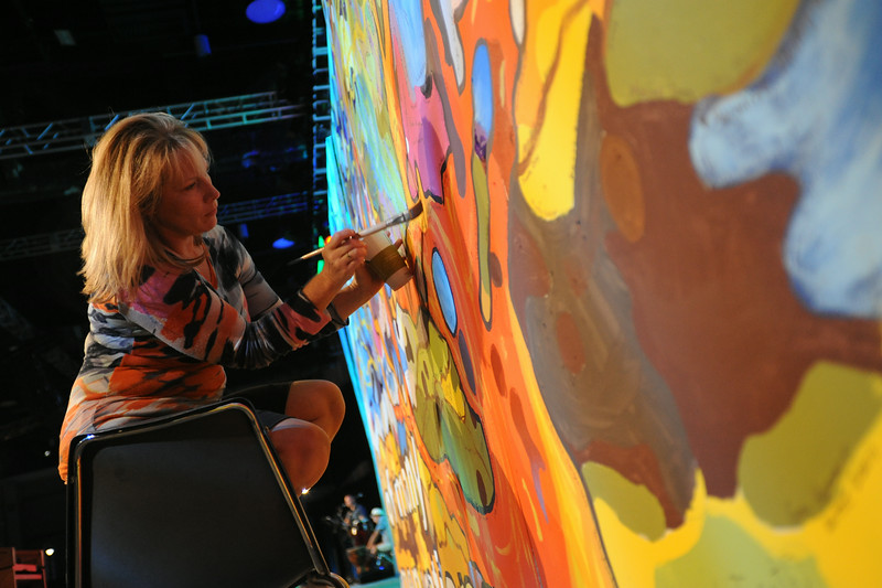 Ninth Triennial Gathering   Artist-in-residence, Stephanie Burke, Charlotte, N.C., Christ Lutheran, works on a massive painting during communion at closing worship.