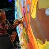 Ninth Triennial Gathering | Artist-in-residence, Stephanie Burke, Charlotte, N.C., Christ Lutheran, works on a massive painting during communion at closing worship.