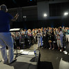 Ninth Triennial Gathering | Worship coordinator, Kevin Anderson directs the chorus during closing worship