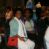 Ninth Triennial Gathering | Mothers and daughter attended the closing worship at the triennial gathering. Mytch Dorvilier, Rockford, IL and daughter, Soraya Dorvilier take their seats before worship begins.
