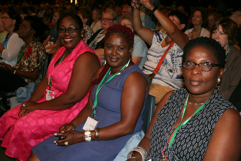 Ninth Triennial Gathering | Pictured from the left: Victoria Gbanoe, Viola Weedor, and Angeline Zayzay, Minneapolis, MN, River of Life Lutheran Church, take their seats before closing worship