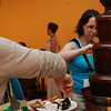 Jessica Morgan (left), Pasco, Wash., and Heidi Patterson, Concord, N.C., dip fruit and marshmallows into the chocolate fountain at Café Chocolate Lounge. EH.
