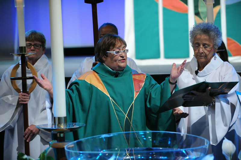 Raquel Rodriguez presides at opening worship, the Thankoffering Service