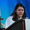 Kylie Contreras reads the lesson at opening worship.