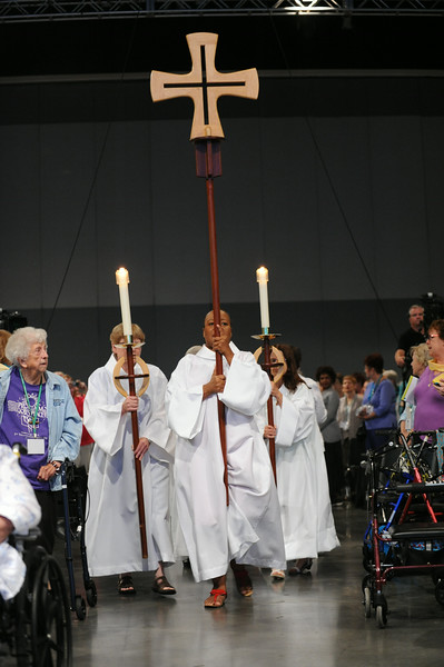 Cross-bearer Rhonda Pruitt, torch-bearers Dawn Smith and Jody Smiley, lead the procession at opening worship.