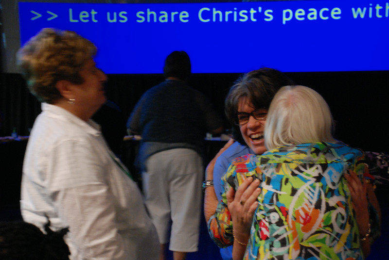 Outgoing Women of the ELCA president Jenny Michaels passes the peace at opening worship. EH.