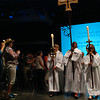 Cross-bearer Rhonda Pruitt, torch-bearers Dawn Smith and Jody Smiley process  at opening worship. EH.