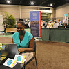 Ninth Triennial Gathering | Dawnya Underwood, Asst. Dir. for Children Services at Lutheran Immigration and Refugee Service, (LIRS), Baltimore, MA, stops by the interactive Women of the ELCA exhibit