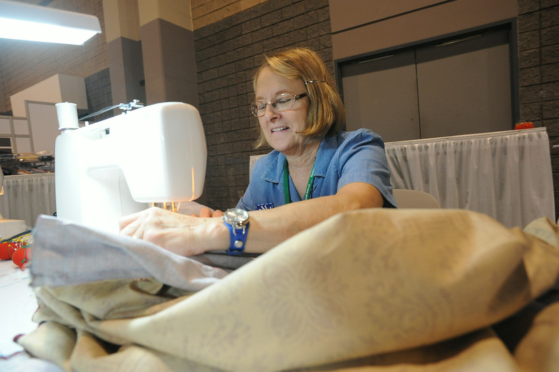 Ninth Triennial Gathering | Cherrilie Vonnahme, Ogden, IA, Immanuel Lutheran, gets to work sewing quilts for Lutheran World Relief (LWR)