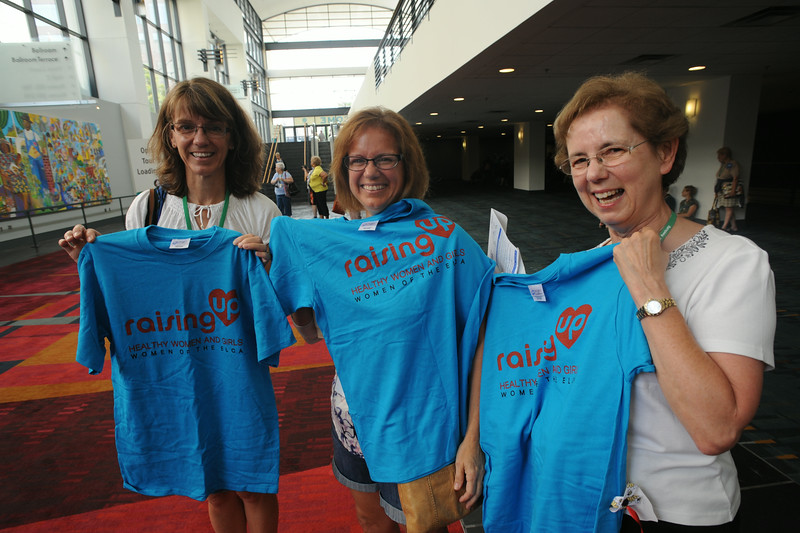 Ninth Triennial Gathering | Sisters Lisa Norman, Kathleen Blake with their mom, Marie Tesch, pose with their Run, Walk and Roll t-shirts