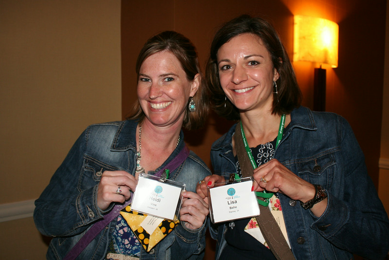 Ninth Triennial Gathering | Heidi Vine (left), Oelwein, Ia. and Lisa Bahe, Stanley, Ia.,  Zion Lutheran, show off their nametags at the Chocolate Lounge, a networking event for women in their 20s and 30s at the gathering.