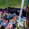 Girl Scouts join Chris Brogan, Abby Arpano and Lija Bennett underneath the recycled art project created by local Girl Scouts in memory of her daughter, Kate Arpano. Six-year-old Kate died in January after a battle with a rare brain cancer. SENTINEL & ENTERPRISE / Ashley Green