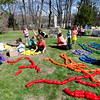 Volunteers string recycled bottles together to create a rainbow at the park on Memorial Drive in Ashburnham. Volunteers and local Girl Scouts gathered on Saturday to create a sculpture in memory of 6-year-old Kate Arpano who died from a rare brain cancer in January. SENTINEL & ENTERPRISE / Ashley Green