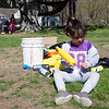 Juliette Roussesu, 5, strings recycled bottles together to create a rainbow at the park on Memorial Drive in Ashburnham. Volunteers and local Girl Scouts gathered on Saturday to create a sculpture in memory of 6-year-old Kate Arpano who died from a rare brain cancer in January. SENTINEL & ENTERPRISE / Ashley Green