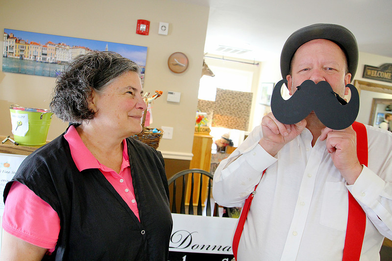 Donna's D'Apolito the owner of Donna's Barbershop in Ashburnham and George Cornwall Jr. had some fun as the talked about the 2015 beard growing contest they are holding to help celebrate the 250th anniversary of the Town of Ashburnham SENTINEL & ENTERPRISE/JOHN LOVE