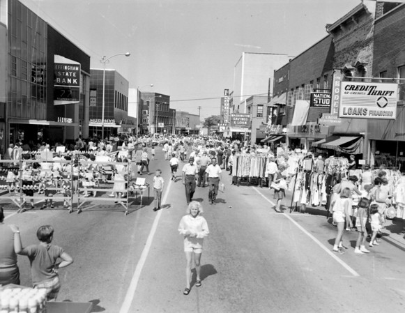 The way sidewalk sale days were in years past. The negative for this photo was marked 1969. Do you remember the stores, or recognize anyone in the photo? If so, share the information online under the photo on the Effingham Daily News Facebook page.