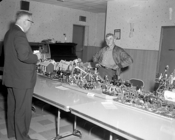 "The sign on the table says ""Wood Carvings"" and the variety and scope of the man's talent is very obvious. Do you recognize the man? The name listed on the sign could be Fred or Ferd and possibly Marten. You can share the information online at the Effingham Daily News Facebook page under the photo."