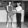 An Effingham High School player and a coach are posed in this photograph. The negative was dated 1966. Do recognize either of the men? If so, share the information under the photo on the Effingham Daily News Facebook page.