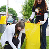 Approximately 350 volunteers from Crossroads Community Church spread out across Main Street on Saturday afternoon to revitalize the downtown area. Kayla Johnson and Yeydi Deya work together to clean up the Green Street Park. SENTINEL & ENTERPRISE/ Ashley Green