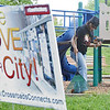 Approximately 350 volunteers from Crossroads Community Church spread out across Main Street on Saturday afternoon to revitalize the downtown area. Genenia Williamson cleans up the Green Street Park. SENTINEL & ENTERPRISE/ Ashley Green