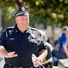 Fitchburg Police Chief Ernie Martineau marches along Main Street during the 4th of July parade on Monday morning. SENTINEL & ENTERPRISE / Ashley Green