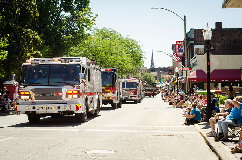 Fire trucks make their way down Main Street during the 4th of July Parade on Monday morning. SENTINEL & ENTERPRISE / Ashley Green