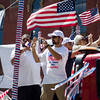 Participants on the Muslims for Peace float wave to spectators during the 4th of July parade on Monday morning. SENTINEL & ENTERPRISE / Ashley Green