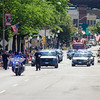 The Fitchburg Police Department makes its way down Main Street to kick off the 4th of July Parade on Monday morning. SENTINEL & ENTERPRISE / Ashley Green