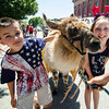 Aidan Corbisiero, 7, and Nicole Sambito, 9, pose with a llama during the 4th of July parade on Monday morning. SENTINEL & ENTERPRISE / Ashley Green