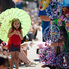 Olivia Reynolds, 5, catches some shade during the 4th of July parade on Monday morning. SENTINEL & ENTERPRISE / Ashley Green