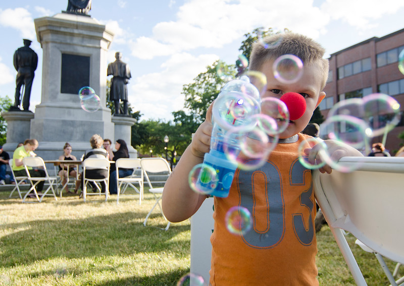 Joshua Ciamataro, 4, plays with a bubble gun during the Civic Days Block Party on Saturday evening. SENTINEL & ENTERPRISE / Ashley Green