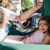 Camila Tirru-Marino, 5, gets her face painted at the Kimatra Maxwell for State Rep. booth during the Civic Days Block Party on Saturday evening. SENTINEL & ENTERPRISE / Ashley Green