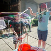 Brandon Piverotto, 7, and Hailey Cochran, 8, play with bubbles sponsored by the Friends of the Fitchburg Library during the Civic Days Block Party on Saturday evening. SENTINEL & ENTERPRISE / Ashley Green