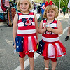 Genevieve, 7, and Trinity Gillespie, 4, show off their most patriotic outfits during the Civic Days Block Party on Saturday evening. SENTINEL & ENTERPRISE / Ashley Green