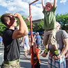 Sgt. Andrew Fetrow looks on as six-year-old Anthony Veneziano gets a lift from dad Josh at the U.S. Marines booth during the Civic Days Block Party on Saturday evening. SENTINEL & ENTERPRISE / Ashley Green