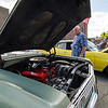 Kevin Snow checks out a 1963 Bel Air on display on Main Street as part of the Ray C. Memorial Classic Car Show during the Civic Days Block Party on Saturday evening. SENTINEL & ENTERPRISE / Ashley Green