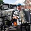 Gibby Lash plays his accordion near his antique car in the Ray C. Memorial Classic Car Show at the Civic Days Block Party on Saturday evening. SENTINEL & ENTERPRISE / Ashley Green