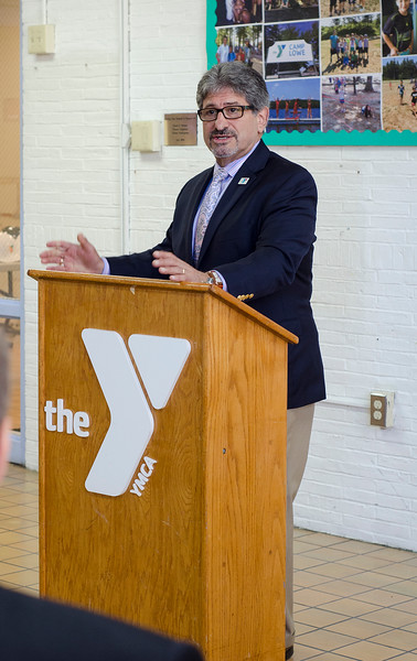 Mayor Stephen DiNatale speaks during the official kickoff to the capital improvement rennovation project at the YMCA in Fitchburg on Wednesday morning. SENTINEL & ENTERPRISE / Ashley Green