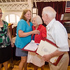 Granddaughter Bonnie Pierce and daughter Susan Comeaux surprise Dorith and Fred Washington after they are named king and queen during the annual Civic Days luncheon at the Senior Center on Friday morning. SENTINEL & ENTERPRISE / Ashley Green