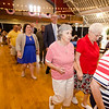 Guests join King and Queen Fred and Dorith Washington in a processional during the annual Civic Days luncheon at the Senior Center on Friday morning. SENTINEL & ENTERPRISE / Ashley Green