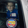 Brandon Myer, 4, peeks out of the back of a Fitchburg Police Department cruiser during Fitchburg's annual DPW Day held on Wednesday. SENTINEL & ENTERPRISE / Ashley Green