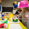 Laura Andrews, 8, creates toy tractor art with paint during Fitchburg's annual DPW Day held on Wednesday. SENTINEL & ENTERPRISE / Ashley Green