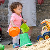 Tatyana Nelson, 1, plays on the sand pile during Fitchburg's annual DPW Day held on Wednesday. SENTINEL & ENTERPRISE / Ashley Green