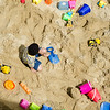 Kids play on the sand pile during Fitchburg's annual DPW Day held on Wednesday. SENTINEL & ENTERPRISE / Ashley Green