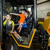 Eli, 3, Jason, 7, and Daniel Daley, 5, check out one of the DPW trucks during Fitchburg's annual DPW Day held on Wednesday. SENTINEL & ENTERPRISE / Ashley Green