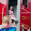 Maeve Palmer, 5, checks out one of the Fitchburg Fire Department trucks during Fitchburg's annual DPW Day held on Wednesday. SENTINEL & ENTERPRISE / Ashley Green
