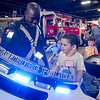 Romeo Gill, 4, checks out the police motorcycle with Officer James McCall during Fitchburg's annual DPW Day held on Wednesday. SENTINEL & ENTERPRISE / Ashley Green