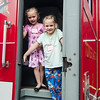 Maeve Palmer, 5, and sister Fiona, 8, check out one of the Fitchburg Fire Department trucks during Fitchburg's annual DPW Day held on Wednesday. SENTINEL & ENTERPRISE / Ashley Green